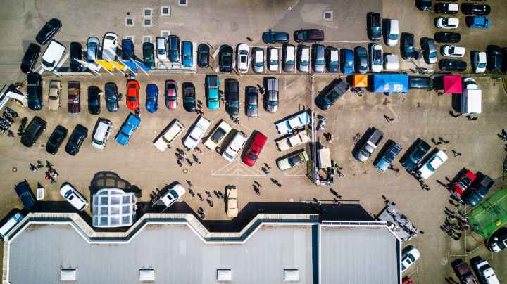 photo from above of vehicles parked near building